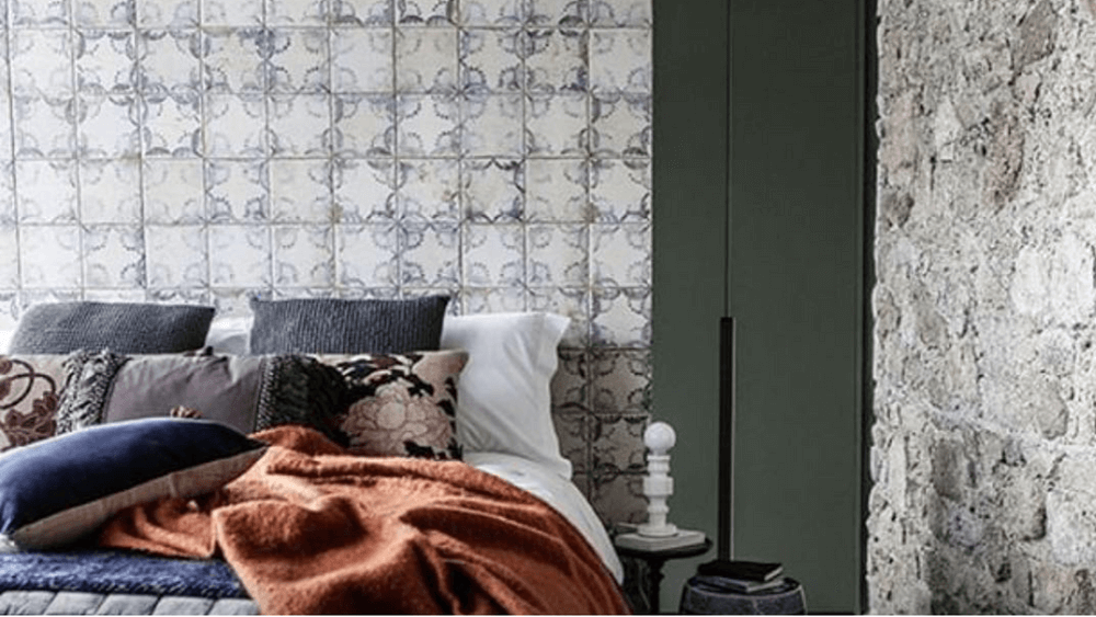 Geometric wallpaper in bedroom. A design trend for 2020